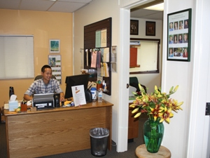 Our reception desk-where you will be greeted by a friendly receptionist who can answer your questions and get you started in the process of meeting with a therapist