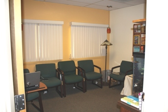 Here is a view of our waiting room.  We have two lovely fish tanks (not pictured).  The fish are a great source of amusement and relaxation